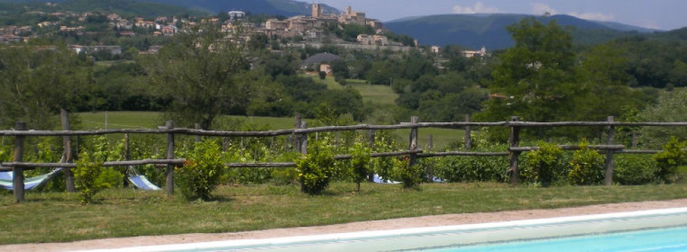 View of Sarnano from the pool at Villa San Raffaello Italy