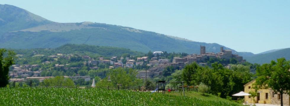 Sarnano and the Sibillini Mountains from the field bhind Villa San Raffaello